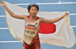 Japan's Kayoko Fukushi reacts after crossing the finish line to place third in the women's marathon final at the World Athletics Championships in the Luzhniki stadium in Moscow, Russia, Saturday, Aug. 10, 2013. (AP Photo/Martin Meissner)